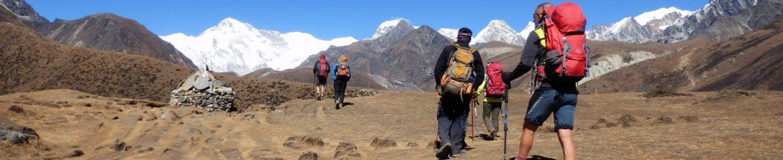 People trekking through the Himalayan landsapce